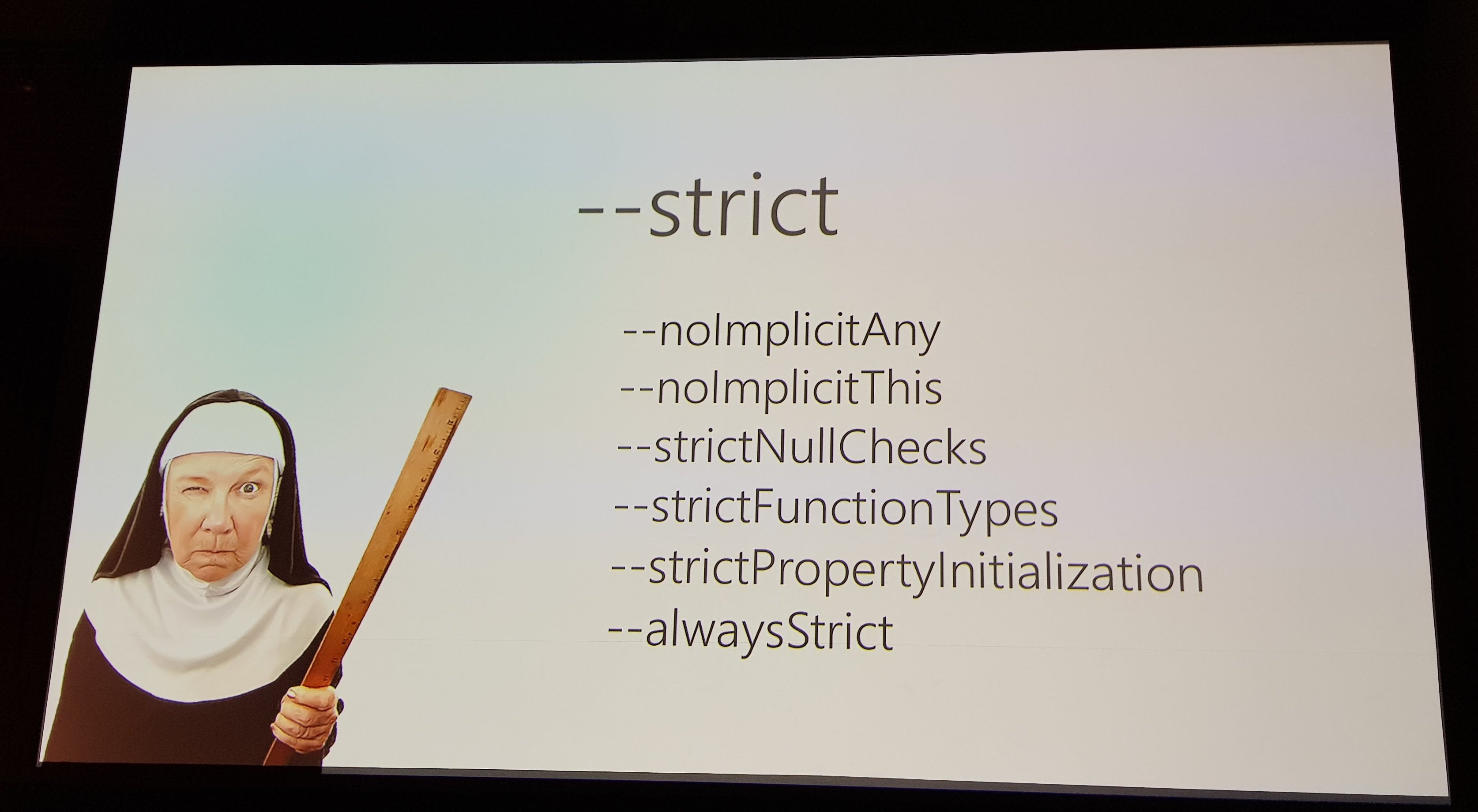 A slide showing a nun with a ruler and talking about strict mode in TypeScript