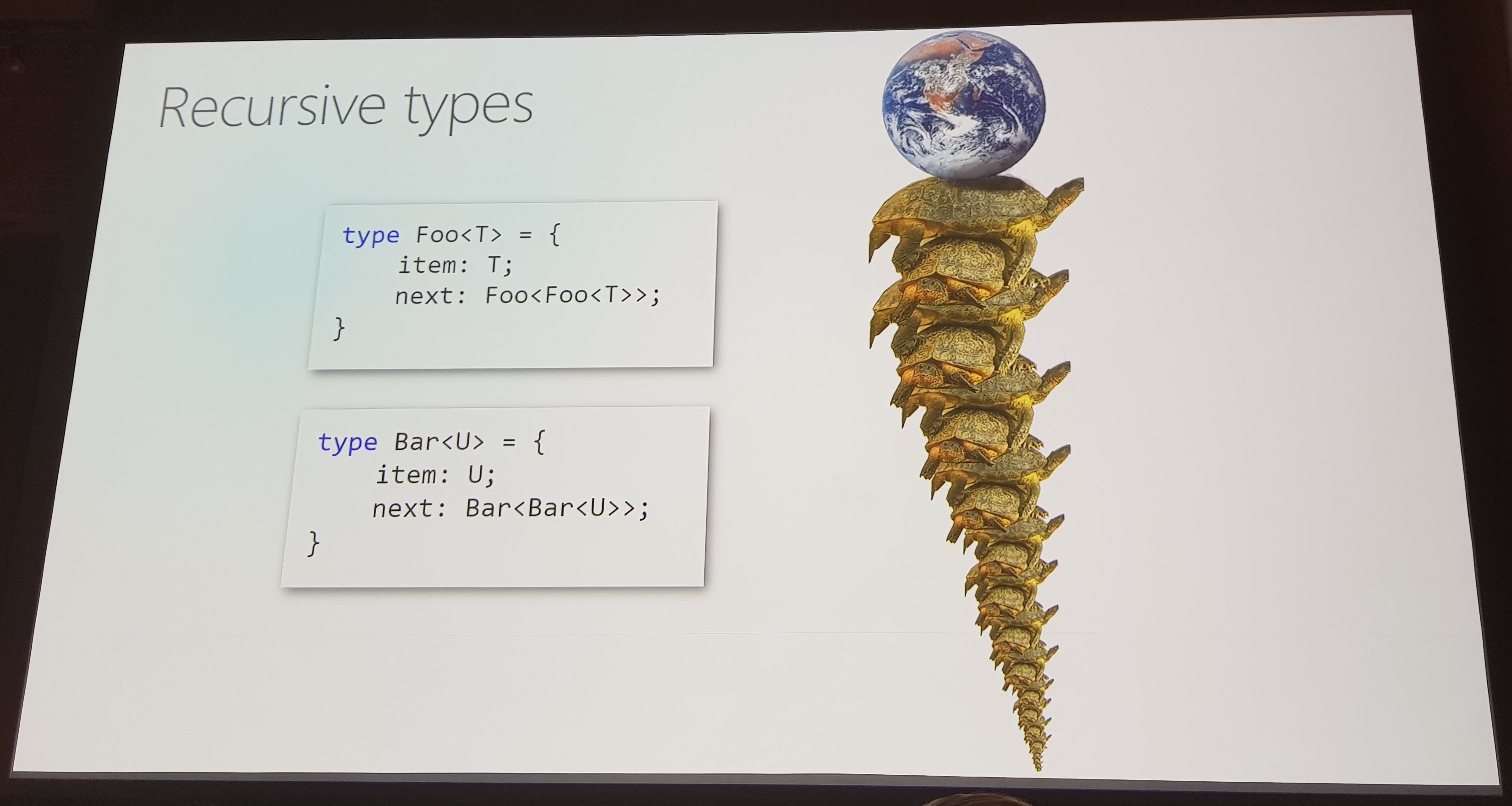 Slide equating recursive types to an infinite stack of turtles supporting the Earth